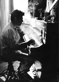 mizrach-mcclelland:    Mastroianni playing piano in pajamas, with cigarette holder. Love.