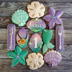 Some Little Mermaid themed cookies for an adorable one year old! Happy first bir… Some little mermaid themed cookies for an adorable one-year-old! Happy first birthday trip! Summer Cookies, Fancy Cookies, Iced Cookies, Cute Cookies, Royal Icing Cookies, Little Mermaid Birthday, Little Mermaid Parties, The Little Mermaid, Little Mermaid Cupcakes