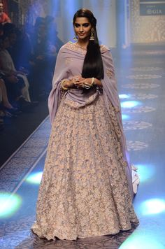 Sonam Kapoor in a delicate and light lilac lehenga.