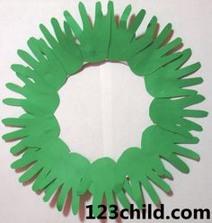 Hand Print Wreath. Trace each child's hands several times onto a piece of green paper. Have the children cut out these hand shapes. Supply each child with a paper plate and show them how to cut out the center of the plate. Have the children glue their green hands shapes onto the plate to make a wreath. You could also have them use a paper hole punch on red paper and glue the holes on for holly.