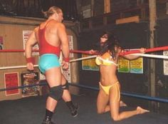 Woman trapped in the ropes in a mixed wrestling match
