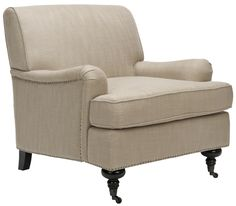 A traditional chair, in a modern linen fabric - always beautiful.  Safavieh Sierra Fabric Club Chair in Beige