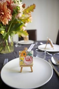 Mini canvas (blank) at place setting as substitute for guest book.
