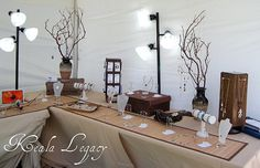 Bamboo runners, driftwood + manzanita branches... very natural. {craft booth setup}