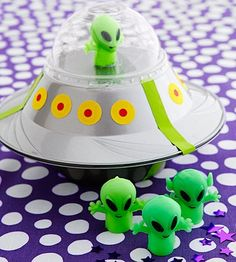 This UFO craft is so awesome it can double as the alien party favor. Let kids decorate plastic bowls with office-supply stickers. Before taping them together, fill with candy. Be sure to add the little green commander of the ship! Alien Crafts, Alien Party, Outer Space Party, Manualidades Halloween, Space Theme, Space Crafts, Party Themes, Crafts For Kids, Plastic Bowls