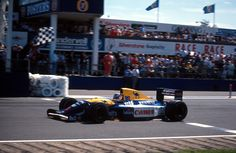 Nigel Mansell winning the 1991 British GP at Silverstone in the FW14