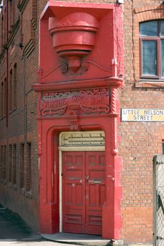 The main door to the old Charter Street Ragger School and Working Girls Home, Dantzic Street, Manchester.