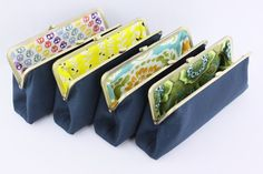 Solid Navy blue bridesmaids clutches with fun inner linings