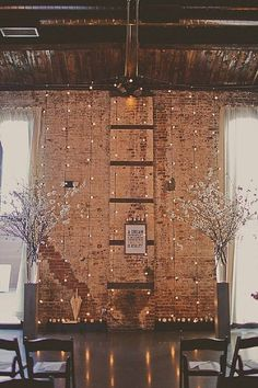 Photo: Stacy Paul Photography via Boho Weddings; Exposed brick gives way to genius loft wedding ideas, especially when it comes to a stylish wedding ceremony.