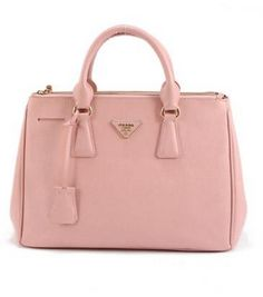 ITEM 4: Pink Prada Bag. Today in the London Underground I saw an impeccably well-dressed woman. She wore black leather jeans a huge black coat that reached her thighs and a brown fur scarf. She also carried a beautiful light pink Prada bag. It was perfection. Now I feel the need to recreate the look for myself. Love London!