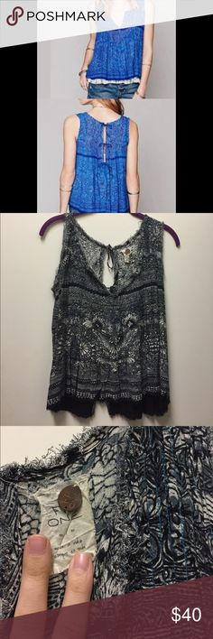 Free People tank Same shirt as first picture, but in a darker color. Free People navy blue patterned tank with tied back. You can't tie it all the way shut, or let it hang open a little bit. Distressed edges. Only worn once! Free People Tops Tank Tops