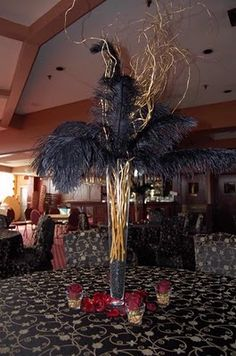 gold branches and black ostrich feathers. Could add hanging jewels Can also make a bit lower