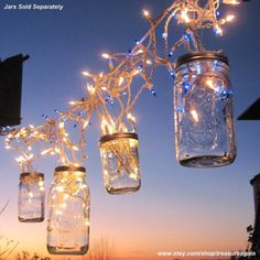 Icicle lights and mason jars make a fun outdoor party light. #IcicleLights #PartyLights
