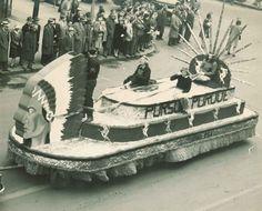 "1947 University of Minnesota Homecoming parade float featuring the slogan, ""Pursue Purdue."""