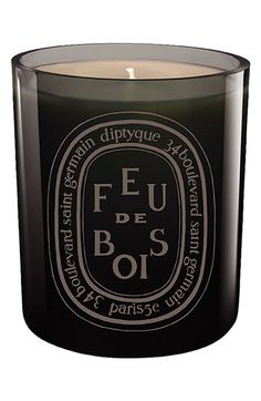 Classic Feu de Bois scent in a mouth-blown glass, colored during production for a shiny finish that lets you see the candle flame. Feu de Bois recalls the warm accord of rare woods throughout the long winter days.