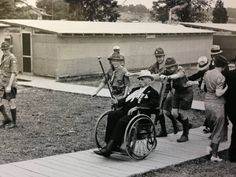 A Civil War Veteran and his Boy Scout escorts at the 1938 Gettysburg reunion.