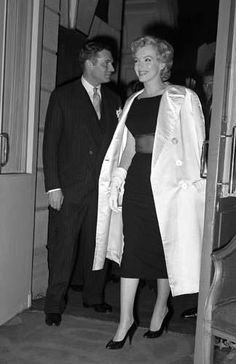 """Marilyn and Laurence Olivier at a press conference for """"The Prince and The Showgirl"""" at the Savoy Hotel, London, July 15th 1956."""