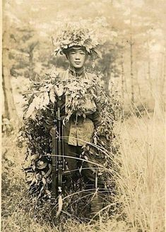 A Japanese Army infantryman in heavy camouflage during a training exercise in Japan, early Military Photos, Military History, Ww1 Photos, Photographs, War Photography, Vintage Photography, Imperial Army, War Dogs, Story Of The World
