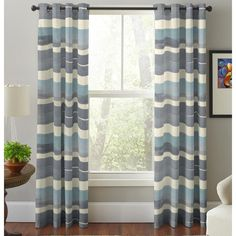 Provide a cool, modern accent to your room with this set of curtain panels featuring grey, white, and blue stripes. These lined cotton curtain panels feature a grommet-style header that slides easily