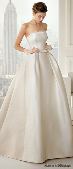Simply beautiful! So many gorgeous wedding dresses for 2015 - see more http://weddings.usabride.com/bridal-trends/gorgeous-simple-wedding-dresses-2015/