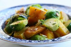 Beautiful golden beets and Brussels sprouts.  Roasted or boiled golden yellow beets with  parboiled Brussels sprouts, sauteed together in olive oil, shallots and thyme, and topped with toasted almonds.