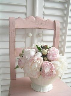 White shutters, pink chair, and soft pink and white flowers!