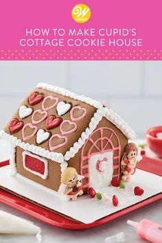 Kids and adults will LOVE making a chocolate cookie cottage this Valentine's Day. Kit includes embossed gingerbread panels for easy decorating plus candy, icing and two cupid icing decorations, ready to add the finishing touch to this cottage. Kid Desserts, Valentines Day Desserts, Valentine Treats, Desserts To Make, Wilton Cake Decorating, Cookie Decorating, Cookie Cottage, Cookie House, Wilton Cakes