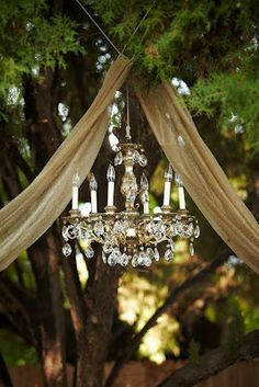 an elegant chandelier at an outdoor wedding?  gorgeous.  #outdoor #wedding #decorations