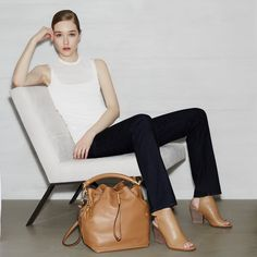 """Complete your outfit with the """"Galey"""" saffiano leather bucket bag + the """"Welsie"""" leather ankle-strap mule bootie from Spring 2015 Calvin Klein white label."""