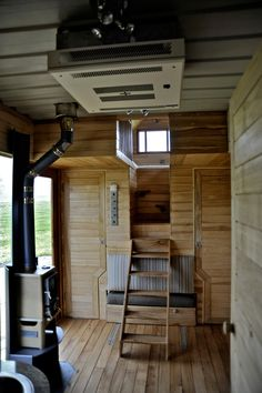 Probably one of the most creative ladders/stairs I've seen in a tiny house!