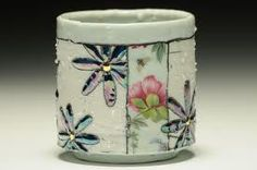 Gillian Parke; porcelain with feldspar inclusions, low frire decals, and lusters.