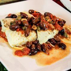 Pressure cooker halibut fillets with tomatoes and olives. Halibut fillets with tomatoes and olives cooked in pressure cooker.Fish cooked in pressure cooker is delicious!