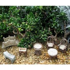Woodland Furniture Set www.teeliesfairygarden.com This lovely woodland furniture set will make elves want to stay in your garden. The mystical bridge, curved bench, fruit trough, water dish, round table, and elven chairs would look perfect in your garden! #fairyfurniture