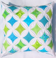 Different cathedral window quilt pillows.