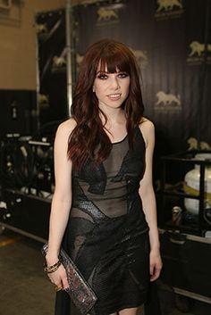 Sporting a new red-hued hairstyle, Carly Rae Jepsen waits for her cue backstage at the 2013 Billboard Music Awards.