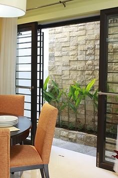 The small outdoor space beside the dining area gives a cozy backdrop to happy breakfasts and romantic dinners.