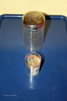 Cheese shaker and toothpicks for fine motor practice.