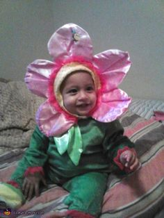 Could find a green onesie and then make the flower hat?