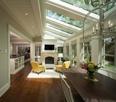 Check out this incredible, light filled room! Those skylights and windows really transform the space.   Transitional Sunroom by Kyle Hunt & Partners, Incorporated