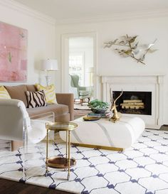 Love the metal piece above the fireplace.   Jenny and Jeff Staubach's Greenway Parks Home - D Magazine
