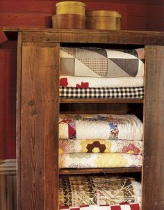 old country quilts-- I want a cabinet like this one day, filled with beautiful quilts that I have made!