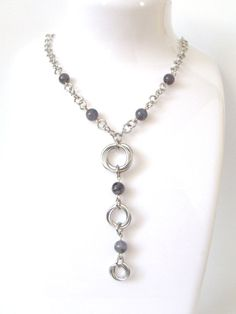 Iolite Mobius Necklace from Aberrant Ginger. Handcrafted with links of violet blue iolite gems this would make an amazing gift for that someone special. Australian based chainmaille jewelry.