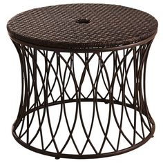 This decorative low table provides extra stability and style for your patio umbrella. Simply place over your existing stand and insert the umbrella down through the center. Handcrafted of easy-care synthetic wicker woven over a rust-resistant iron frame, it's a great place to set candles, potted plants and flowers.