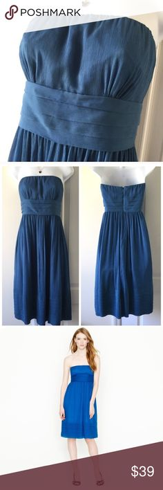 J. Crew Juliette Blue Silk Strapless Dress 8 P It's in very good condition. Silk chiffon all around with a polyester lining. It has a little elastic in the bust so it has maybe an inch to spare. The bust stretches from 34-36 inches. The waist is 31 inches and the length, not including the space between your shoulders and the top of the dress, is 33 inches. The size is 8 petite. J. Crew Dresses Strapless