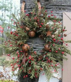 tinywhitedaisies made a festive evergreen and berry wreath accented with vintage jingle bells...