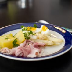 white asperges with ham, egg, sauce and potatoes....a traditional dutch dish!