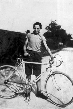 Coppi and his first race bike - sometime in the 1930's! Beginning of a legend!