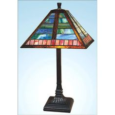 Brilliant blues, reds and oranges light up this craftsman style stained glass table lamp.