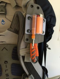 Knife, lighter, ExoTac fire striker in custom Kydex sheath...rides on my backpack at all times.