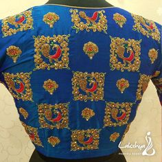 Beautiful bllue color designer blouse with peacock and floral design hand embroidery gold thread and kundan work. Stylish Blouse Design, Fancy Blouse Designs, Bridal Blouse Designs, Saree Blouse Designs, Blouse Patterns, Hand Work Blouse Design, Embroidery Saree, Hand Embroidery, Embroidery Designs